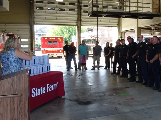 Chillicothe firefighters and police officers listen