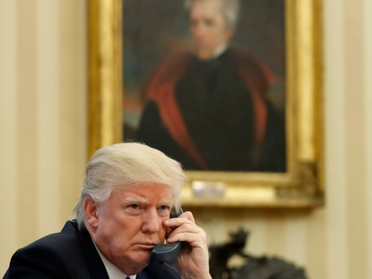 President Trump speaks on the phone in the Oval Office