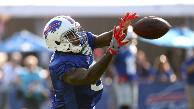 Bills receiver Robert Foster catches a short pass over the middle during training camp.
