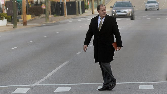 Former Massey Energy CEO Don Blankenship makes his way across Virginia Street in Charleston, W.Va., before entering the Robert C. Byrd Federal Courthouse for his sentencing on April 6, 2016.