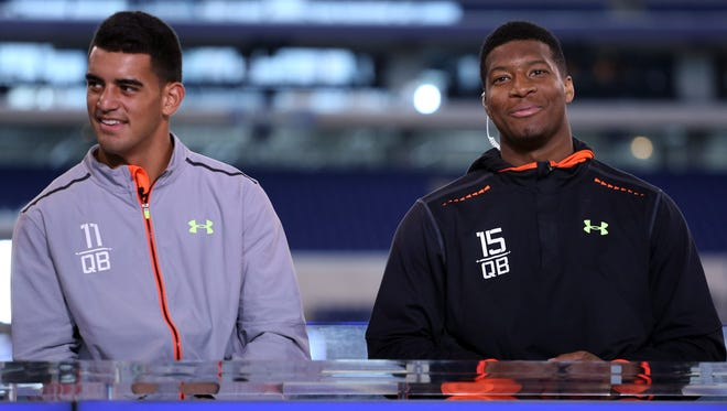 Feb 21, 2015: Florida State quarterback Jameis Winston (right) and Oregon Ducks quarterback Marcus Mariota do an interview on the NFL Network after finishing their workout during the 2015 NFL Combine at Lucas Oil Stadium.