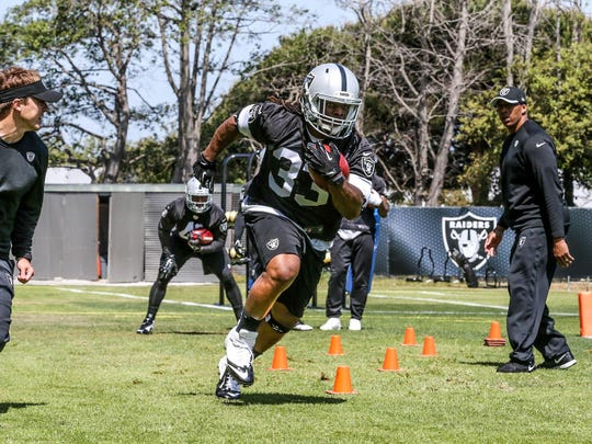 Trent Richardson shown in this file photo during Oakland Raiders workouts, has been cut from the Baltimore Ravens.