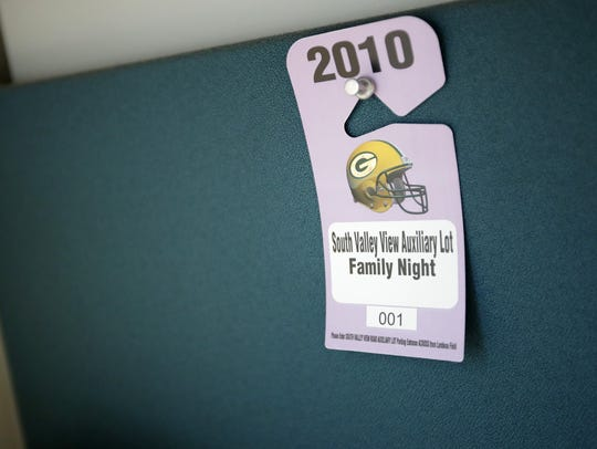 A parking pass for Packers Family Night hangs on the wall of Bruce Hetzler's office at Lawrence University. Hetzler is a member of a local ring of the International Brotherhood of Magicians and will perform at an event Saturday night at the Radisson Paper Valley Hotel.Danny Damiani/USA TODAY NETWORK-Wisconsin.