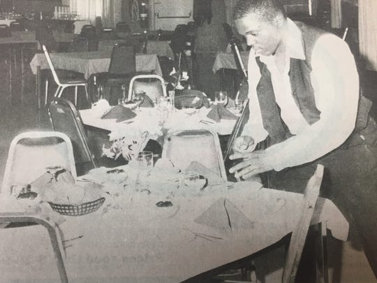 James King, of Chicago, Illinois, prepared a table for a visiting group of senior citizens at Earle C. Clements Job Corps in March 1990.
