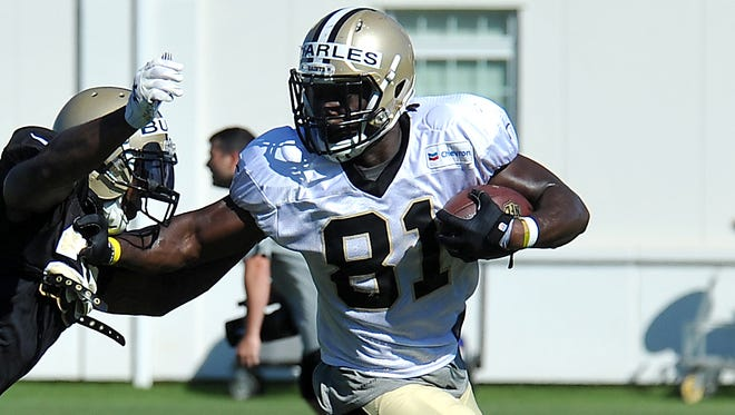 New Orleans Saints tight end Orson Charles tries to fight off a defender during training camp in White Sulphur Springs, W. Va., on Aug. 3, 2015.