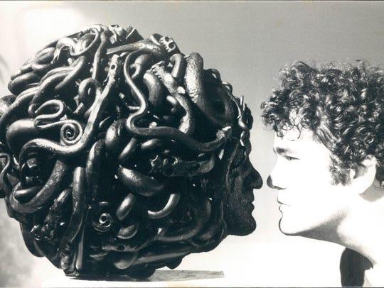 "Michael Malpass with his ""Medusa"" sculpture in 1977."