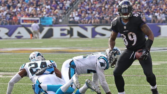 Baltimore Ravens wide receiver Steve Smith (89) rises to his feet after a first down catch and run against the Carolina Panthers at M&T Bank Stadium.