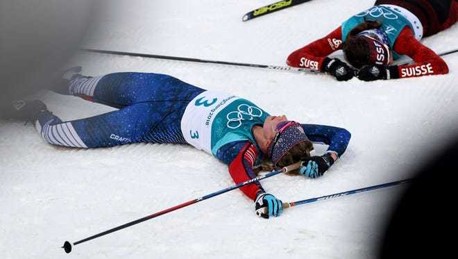 Jessica Diggins (USA) collapses after competing in the women's cross-country 15K skiathlon.