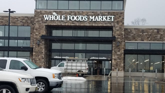 Workers are putting the finishing touches on the new Whole Foods in Bridgewater, which is scheduled to open in March.