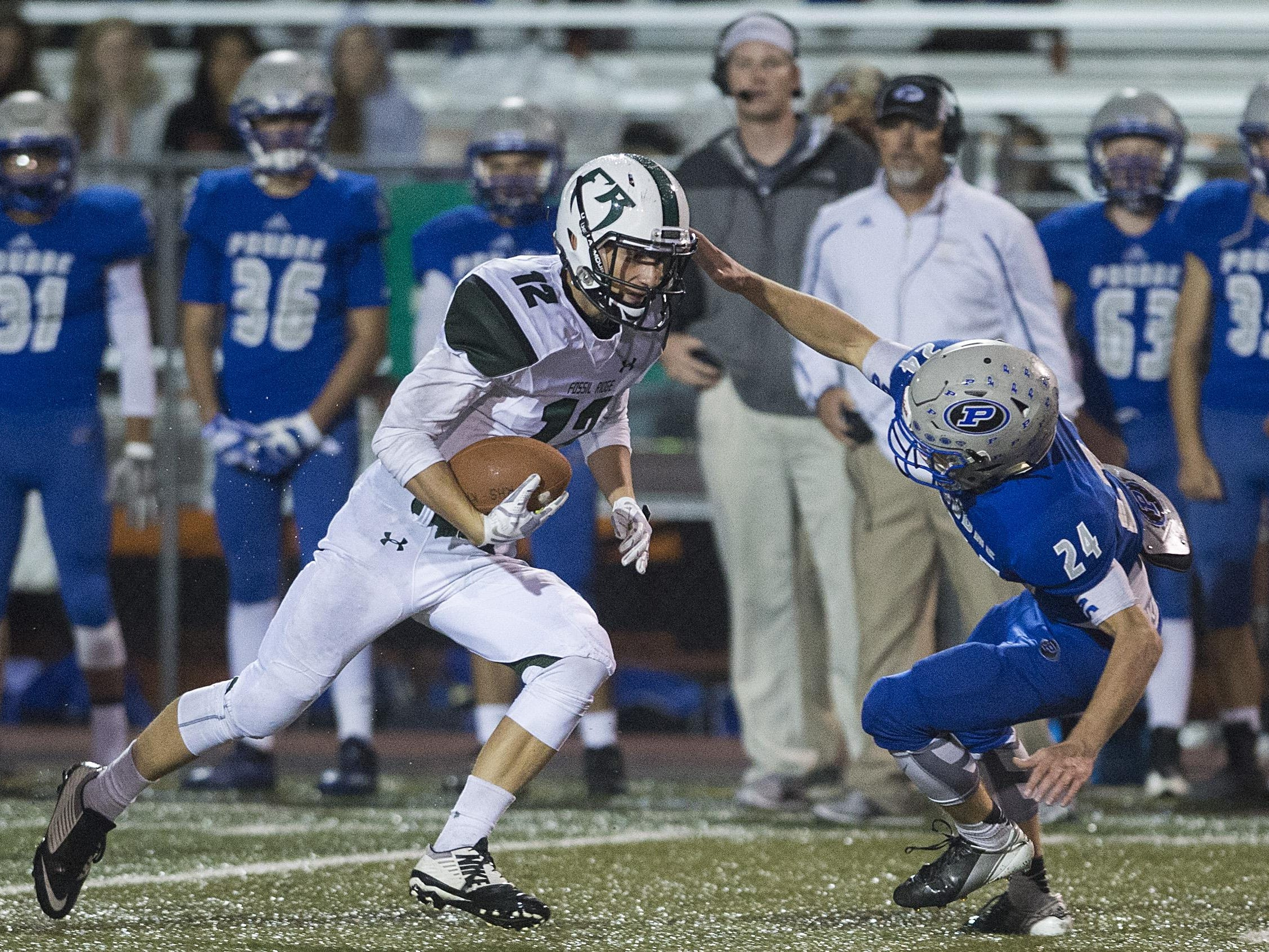 Fossil Ridge High School wide receiver Alec Mullen, left, is one of the area leaders in receiving. Poudre's Jason Wooldridge, right, is one of the top locals in interceptions.