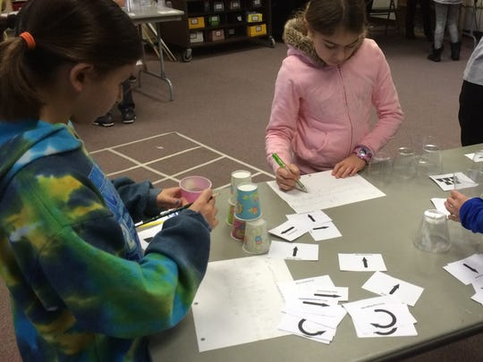 """""""To celebrate the Hour of Code initiative, 4th grade students, Riley Engman and Sofia Bargash, are writing code to build a cup tower."""""""