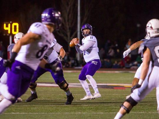 Weber State quarterback Stefan Cantwell (11) drops