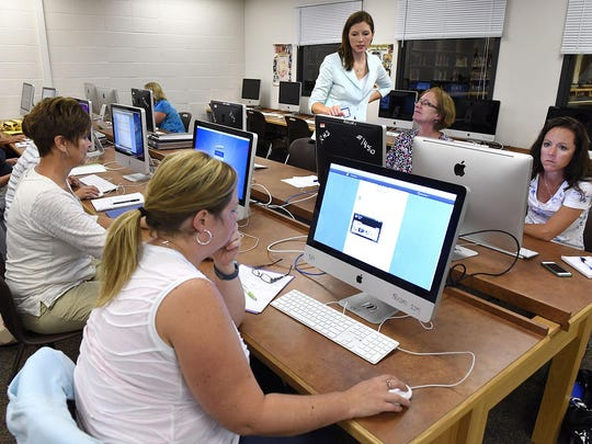 Aileen Swenson, Albany Area Schools, works with area teachers to learn about the program Kids Blog during a technology class Thursday at Rocori High School in Cold Spring.