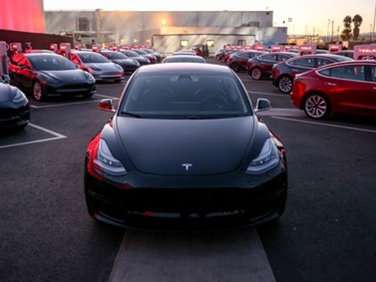 Numerous Model 3 vehicles at the delivery event last year