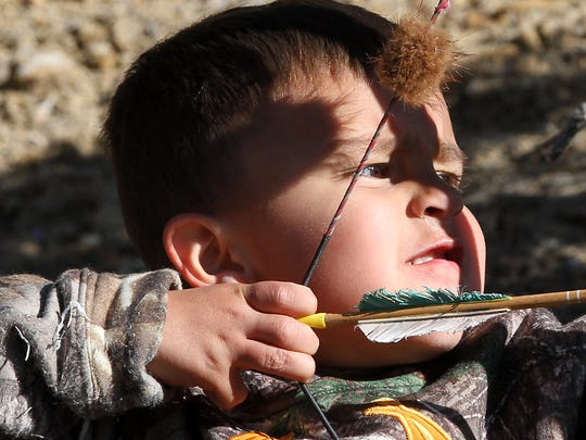 Nate Castillo, 4, takes aim at a target from 7 yards away during the Chokecherry 3D Shoot on Saturday at the San Juan Archers range in Farmington.