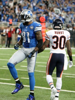 Detroit Lions Calvin Johnson catches a touchdown pass against  the Chicago Bears Kyle Fuller during first half action on Thursday, November 27, 2014 at Ford Field.