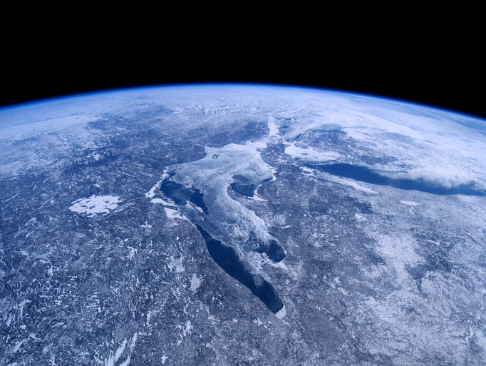 The Great Lakes, covered in ice and snow, as seen from