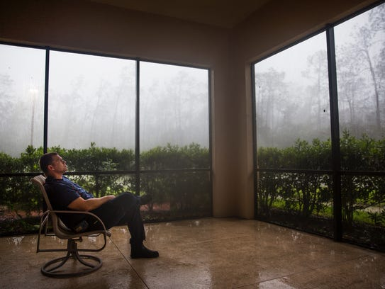 Captain Jason Sellers sits in the lanai as Hurricane