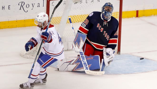Rangers goalie Henrik Lundqvist (30) reacts after Canadiens left wing Paul Byron (41) scored in the shootout of a Tuesday's game in New York. The Montreal won 3-2.