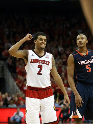 Louisville's Quentin Snider celebrates as Virginia's Darion Atkins feels the game slipping away Saturday.