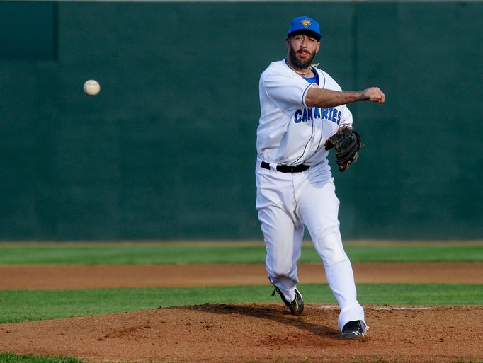 Kyle Ruwe pitches for the Canaries as they take on Laredo in Tuesday night's game in Sioux Falls, July 15, 2014.