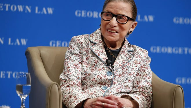 Supreme Court Justice Ruth Bader Ginsburg  smiles as she takes questions from first-year students at Georgetown Law in 2018 in Washington.