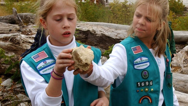 Girl Scouts Grace McCullough, left, and Hannah Brotzge inspected a fossil yesterday at the Falls of the Ohio State Park in Clarksville, Ind.