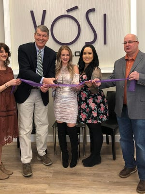 Raritan Mayor Chuck McMullin and Councilman Don Tozzi join Paula Biekisz and her staff for the grand opening of Vosi Salon in Raritan Borough.