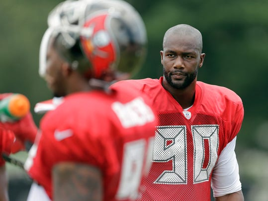Tampa Bay Buccaneers defensive end Michael Johnson (90) takes a break during an NFL football training camp Monday, July 28, 2014, in Tampa, Fla. (AP Photo/Chris O'Meara)