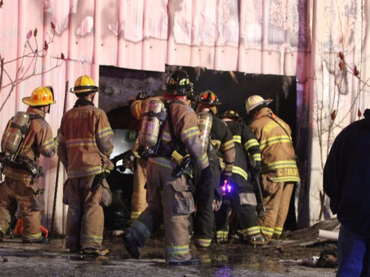 A fire that did heavy damage to a commercial building in New Castle late Friday night is under investigation, the state fire marshal's office said Saturday.