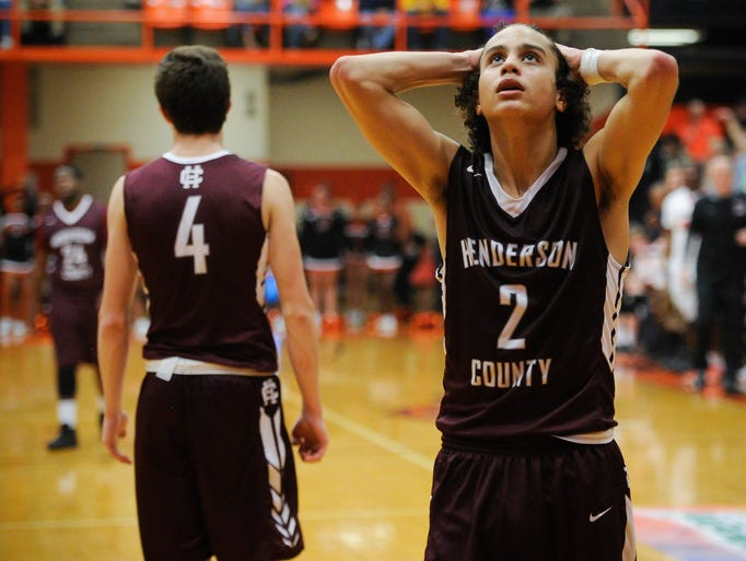 Henderson County's Taye Calloway (2) reacts late in