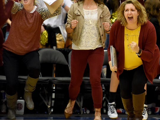 Harrisburg's head volleyball coach  Ronette Costain screams in celebration of their victory over Roosevelt during the S.D. State AA Volleyball championship at the Swiftel Center in Brookings.