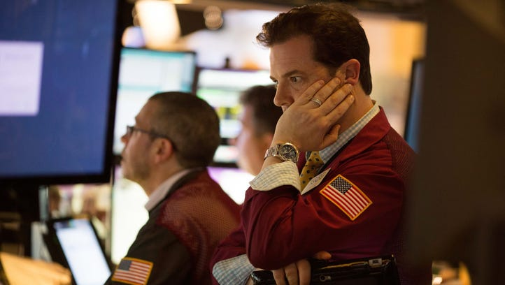 Traders finish the day at the New York Stock Exchange