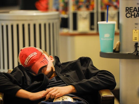 Tyler Hodge, 17, sleeps inside Opry Mills Mall after shopping for more than 24 hours to get Black Friday sales on Friday, Nov. 25, 2016.