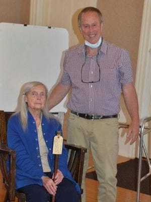 Selectman Ed Beattie awards Maurine Perkins Stard with the Boston Post Cane.