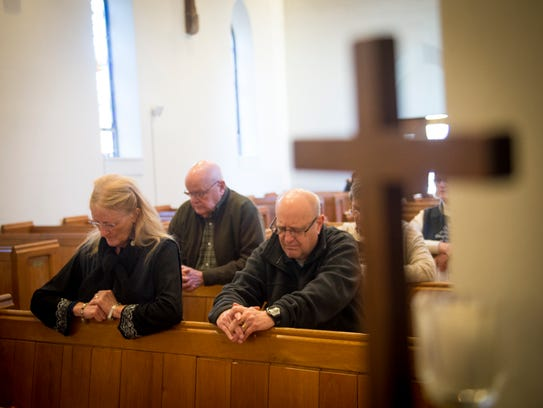 """Trinity Episcopal parishioners pray during a """"time"""