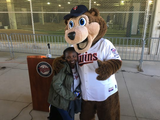 A student gets a hug and a photo with T.C., the Twins'