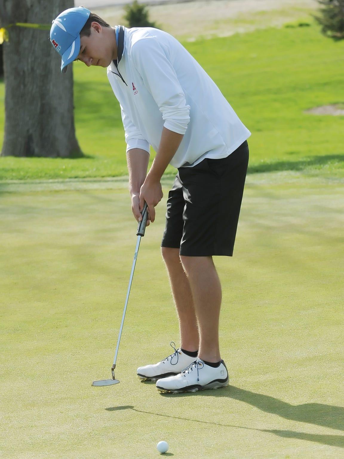Arrowhead's Bennett Knapek watches a short putt run