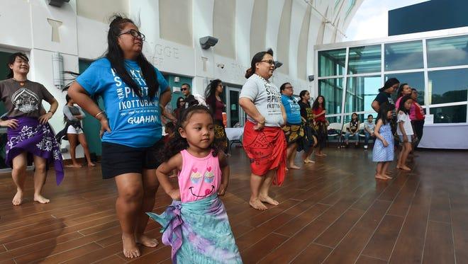 Kassidy Nuncio-Quichocho, 3, participates in a cultural dance lesson during Nihi ta Fan Baila at the Guam Museum on Feb. 10, 2018.