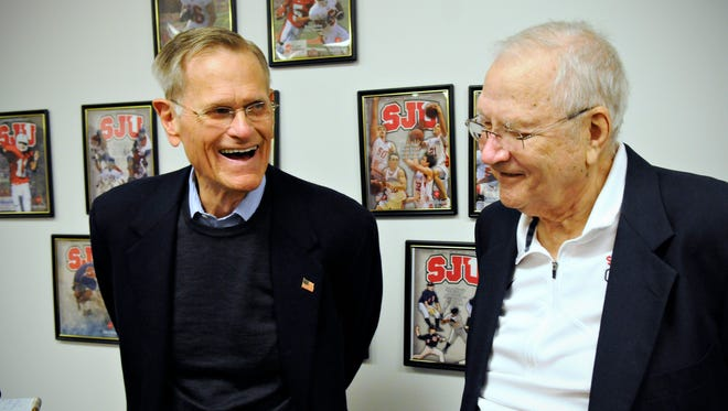 Tom Love, chairman and CEO, Love's Travel Stops and Country Stores, reminisces with his former football coach John Gagliardi on Monday at St. John's University.