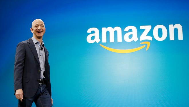 Amazon CEO Jeff Bezos walks onstage in Seattle for the launch of the new Amazon Fire Phone.