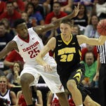 Iowa forward Jarrod Uthoff drives to the basket as Dayton's Kendall Pollard defends during the first half on Thursday in Orlando, Fla. Uthoff scored a team-high 18 points in the Hawkeyes' 82-77 loss.