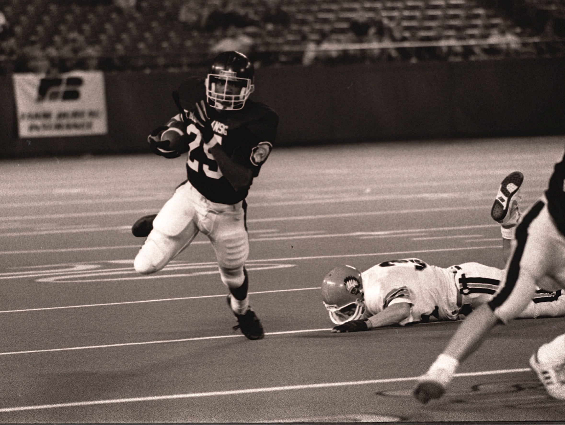 East Lansing's Randy Kinder helped the Trojans defeat Birmingham Brother Rice, 14-0, in the 1991 Class A state football championship game at the Pontiac Silverdome.
