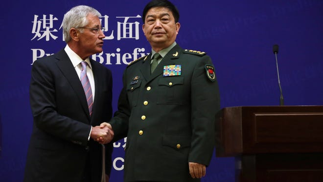 U.S. Defense Secretary Chuck Hagel, left, and Chinese Defense Minister Chang Wanquan shake hands at the end of a joint news conference in Beijing, China, on April 8, 2014.
