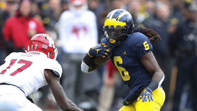 Michigan running back Kareem Walker scored his first career touchdown on Saturday against Rutgers, but also left the game with a foot injury.