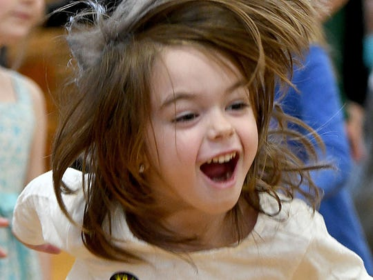 Tessa Liming enjoys dancing Friday afternoon during