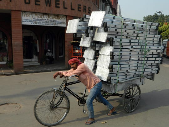 Good balance would be a requisite for transporting this kind of load.