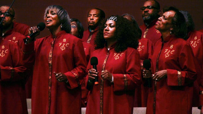 Catherine Boone, left, sings with members of the First Baptist Mass Choir during the church's opening celebration service marking its 150th anniversary.