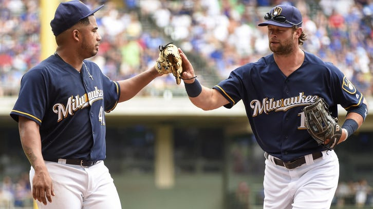 Milwaukee Brewers pitcher Junior Guerra, left, thanks center fielder Kirk Nieuwenhuis after Chicago Cubs' Tommy La Stella was thrown out trying to stretch a single into a double during the fifth inning of a baseball game Sunday, July 24, 2016, in Milwaukee. (AP Photo/Benny Sieu)