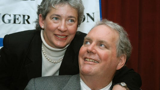 A photo shows John Tull with his wife, Lucinda Marker.